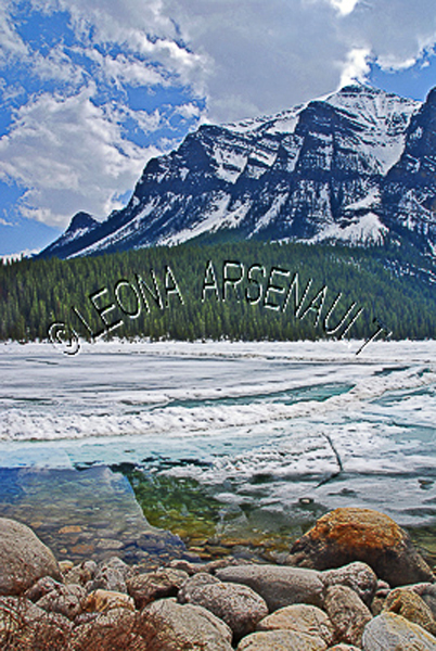 CANADA;ALBERTA;BANFF NATIONAL PARK;ROCKY MOUNTAIN;CANADIAN ROCKIES;LAKE LOUISE;ROCKS;SNOW;WATER;LAKES;SPRING;REFLECTIONS;WATERSCAPE;LANDSCAPE;SCENIC;VERTICAL
