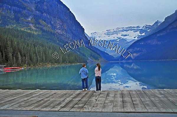 CANADA;ALBERTA;BANFF NATIONAL PARK;ROCKY MOUNTAIN;CANADIAN ROCKIES;LAKE LOUISE;CHILDREN;SNOW;WATER;LAKES;SPRING;REFLECTIONS;WATERSCAPE;LANDSCAPE;SCENIC;HORIZONTAL