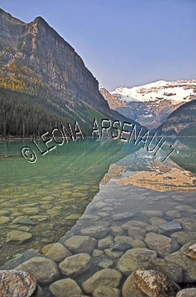 CANADA;ALBERTA;BANFF NATIONAL PARK;ROCKY MOUNTAIN;CANADIAN ROCKIES;LAKE LOUISE;ROCKS;SNOW;WATER;LAKES;REFLECTIONS;FALL;WATERSCAPE;LANDSCAPE;SCENIC;VERTICAL