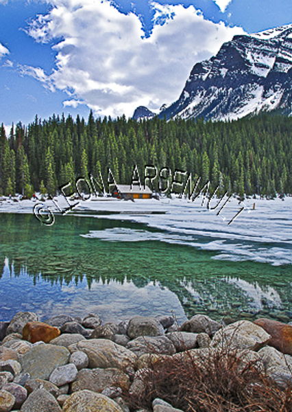 CANADA;ALBERTA;BANFF NATIONAL PARK;ROCKY MOUNTAIN;CANADIAN ROCKIES;LAKE LOUISE;ROCKS;SNOW;WATER;REFLECTIONS;LAKES;FALL;WATERSCAPE;LANDSCAPE;SCENIC;VERTICAL