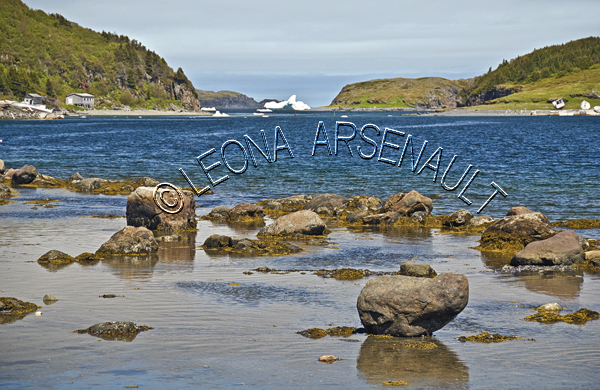 CANADA;NEWFOUNDLAND;ST LUNAIRE-GRIQUET;WATER;COASTAL;ICEBERG;ROCKS;SUMMER;NAUTICAL;SEASCAPE;SCENIC;HORIZONTAL;