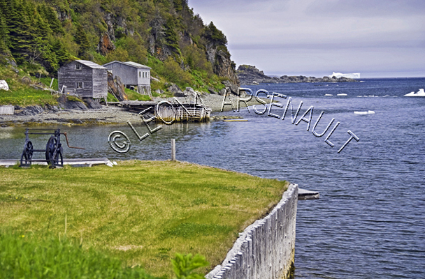 CANADA;NEWFOUNDLAND;ST LUNAIRE-GRIQUET;WATER;COASTAL;SHEDS;SHACKS;ICEBERG;NAUTICAL;CLIFF;SUMMER;SEASCAPE;SCENIC;HORIZONTAL;