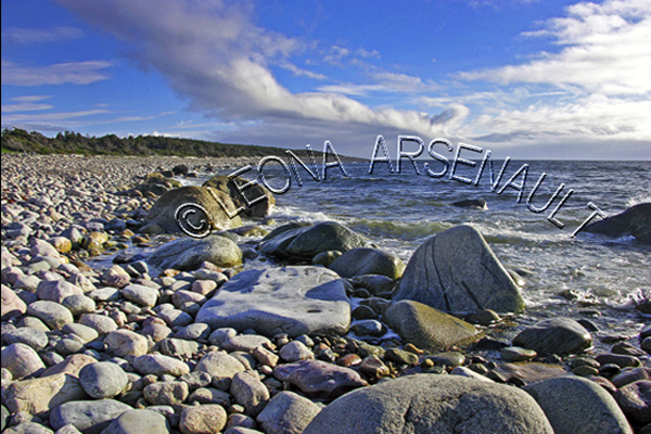 CANADA;NEWFOUNDLAND;GROS MORNE NATIONAL PARK;LOBSTER COVE;ROCKS;SHORES;CLOUDS;WATER;BONNE BAY;COASTAL;NAUTICAL;SUMMER;WATERSCAPE;SCENIC;HORIZONTAL;