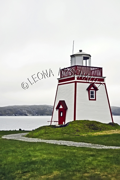 CANADA;NEWFOUNDLAND;ST ANTHONY ;LIGHTHOUSE;NAUTICAL;WATER;SUMMER;SEASCAPE;VERTICAL