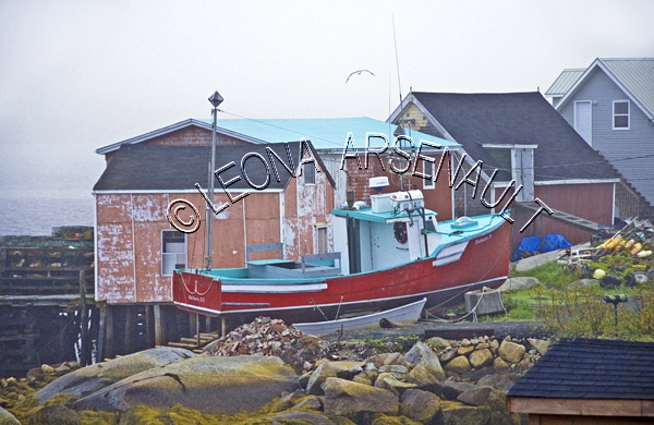 CANADA;NOVA SCOTIA;PEGGY'S COVE;WATER;BOAT;DORY;COASTAL;NAUTICAL;BUILDINGS;FISHING;SHACK;SHED;HARBOUR;PIER;WHARF;SPRING;SEASCAPE;LANDSCAPE;SCENIC;HORIZONTAL;