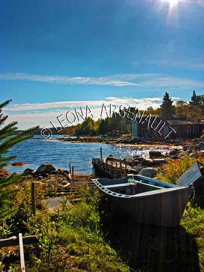 CANADA;NOVA SCOTIA;PEGGY'S COVE;FALL;WATER;BOATS;DORIES;SUNRISES;NAUTICAL;WATERSCAPE;LANDSCAPE;SCENIC;VERTICAL;