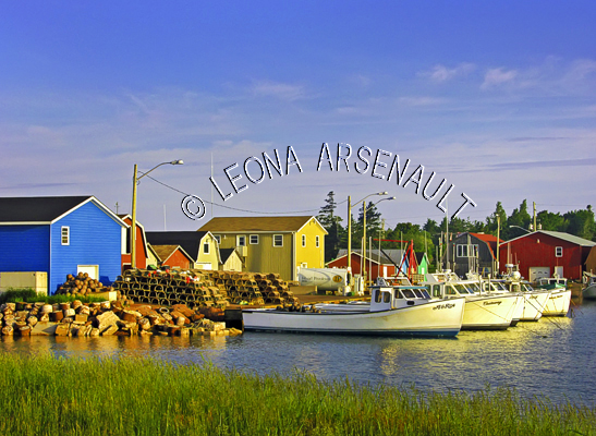 CANADA;PRINCE EDWARD ISLAND;PRINCE COUNTY;MALPEQUE;MALPEQUE HARBOUR;HARBOURS;PIERS;WHARFS;FISHING BOATS;BOATS;SHACKS;SHEDS;LOBSTER TRAPS;TRAPS;NAUTICAL;WATER;BUILDINGS;SUMMER;SEASCAPES;SCENIC;HORIZONTAL