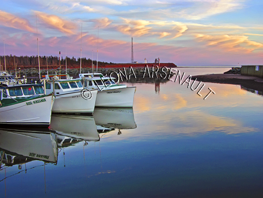 CANADA;PRINCE EDWARD ISLAND;PRINCE COUNTY;CAP-EGMONT;HARBOURS;PIERS;WHARFS;FISHING BOATS;BOATS;SUNSETS;DUSK;SPRING;REFLECTIONS;NAUTICAL;SEASCAPES;SCENIC;HORIZONTAL