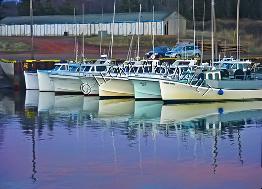 CANADA;PRINCE EDWARD ISLAND;PRINCE COUNTY;CAP-EGMONT;HARBOURS;PIERS;WHARFS;FISHING BOATS;BOATS;SUNSET;DUSK;SPRING;NAUTICAL;REFLECTIONS;SEASCAPES;SCENIC;HORIZONTAL