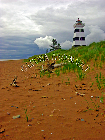 CANADA;PRINCE EDWARD ISLAND;PRINCE COUNTY;WEST POINT LIGHTHOUSE;LIGHTHOUSES;NAUTICAL;CLOUDS;SPRING;BEACHES;SAND;LANDSCAPE;SCENIC;VERTICAL