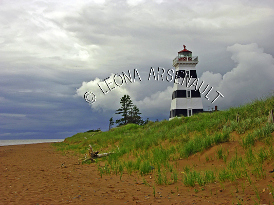 CANADA;PRINCE EDWARD ISLAND;PRINCE COUNTY;WEST POINT LIGHTHOUSE;;LIGHTHOUSES;NAUTICAL;SPRING;CLOUDS;BEACHES;SAND;LANDSCAPE;HORIZONTAL