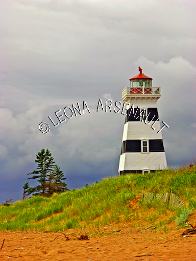 CANADA;PRINCE EDWARD ISLAND;PRINCE COUNTY;WEST POINT LIGHTHOUSE;LIGHTHOUSES;NAUTICAL;SPRING;CLOUDS;BEACHES;SAND;LANDSCAPE;SCENIC;VERTICAL
