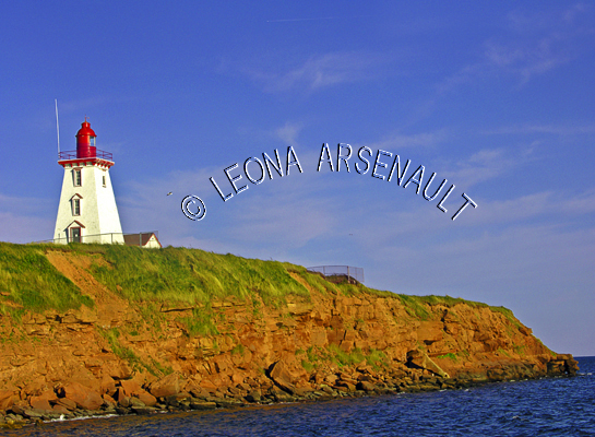 CANADA;PRINCE EDWARD ISLAND;KING'S COUNTY;SOURIS;CLIFFS;WATER;LIGHTHOUSES;NAUTICAL;SUMMER;LANDSCAPE;SCENIC;HORIZONTAL