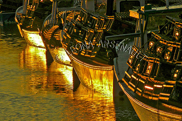 CANADA;PRINCE EDWARD ISLAND;PRINCE COUNTY;ABRAM-VILLAGE;FISHING BOATS;BOATS;REFLECTION;LOBSTER TRAPS;TRAPS;SUNSET;DUSK;WATER;NAUTICAL;SEASCAPE;HORIZONTAL