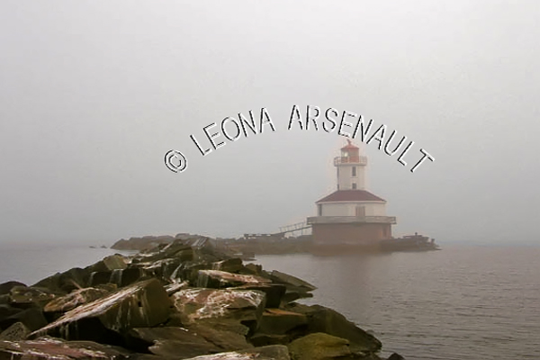 CANADA;PRINCE EDWARD ISLAND;PRINCE COUNTY;SUMMERSIDE;LIGHTHOUSES;INDIAN HEAD LIGHTHOUSE;ROCKS;FOG;WATER;SEASCAPE;SCENIC;HORIZONTAL