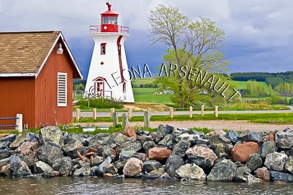 CANADA;PRINCE EDWARD ISLAND;QUEEN'S COUNTY;VICTORIA BY THE SEA;LIGHTHOUSE;ROCKS;SHED;NAUTICAL;WATER;SUMMER;LANDSCAPE;SCENIC;HORIZONTAL