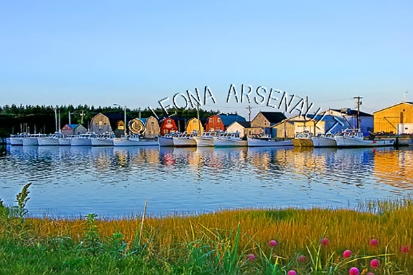 CANADA;PRINCE EDWARD ISLAND;PRINCE COUNTY;MALPEQUE;SHEDS;BOATS;HARBOUR;PIER;WHARF;WATER;NAUTICAL;REFLECTION;SUMMER;SEASCAPE;SCENIC;HORIZONTAL