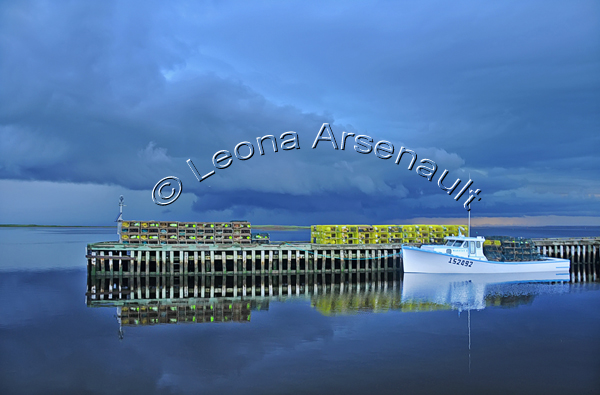 CANADA;PRINCE EDWARD ISLAND;ABRAM-VILLAGE;PRINCE COUNTY;BOATS;LOBSTER TRAPS;TRAPS;WATER;WARF;PIER;DOCK;REFLECTION;SEASCAPE;HORIZONTAL
