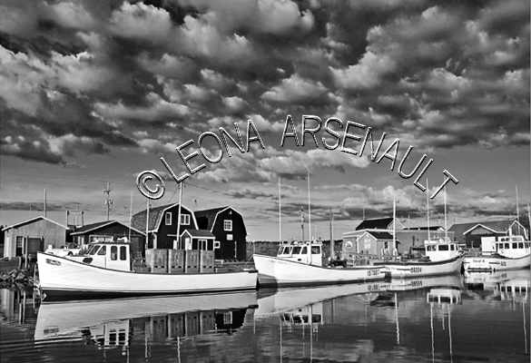 CANADA;PRINCE EDWARD ISLAND;QUEEN'S COUNTY;STANLEY BRIDGE;FISHING BOATS;BOATS;REFLECTIONS;CLOUDS;WATER;NAUTICAL;BLACK AND WHITE;SEASCAPE;SCENIC;HORIZONTAL