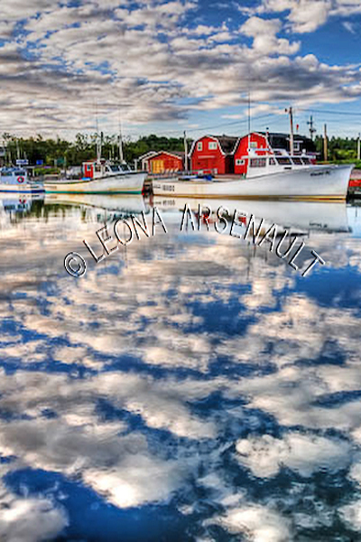 CANADA;PRINCE EDWARD ISLAND;QUEEN'S COUNTY;STANLEY BRIDGE;NAUTICAL;BOATS;FISHING BOATS;SHEDS;SHACKS;WATER;PIER;WHARF;HARBOUR;CLOUDS;SUMMER;REFLECTION;SEASCAPE;SCENIC;VERTICAL